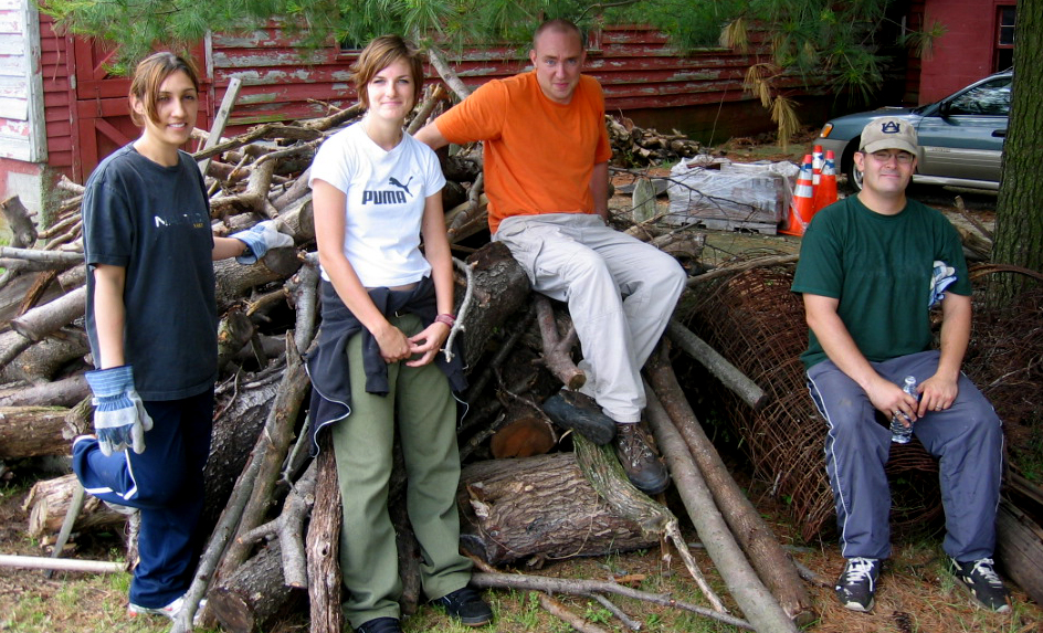 Volunteers - McGuire Taking a Break on Woodpile