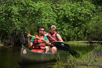 Canoers explore a the Batso River with Pinelands Adventures.