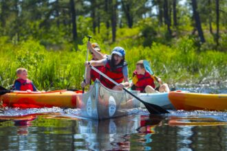 kids and children canoeing and kayaking in the pine barrens of new jersey, nj pinelands