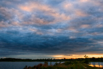 Cloudy Sunset Sky At The Bogs by Aleja Estronza