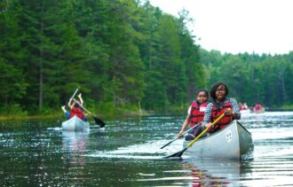 teens canoeing in the new jersey pine barrens